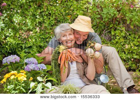 Man hugging his woman in the garden