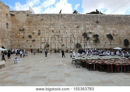 Jerusalem, Israel - November 2 , 2016: Orthodox Jewish Men at the Western Wall in Jerusalem, Judaism's holiest site