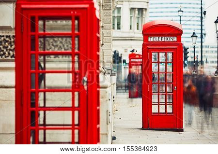 Crowd of people and red telephone boxes on the street in London The United Kingdom of Great Britain and Northern Ireland