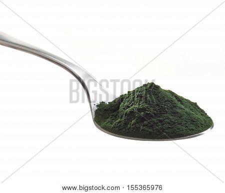 Spoon of spirulina algae powder isolated on white background