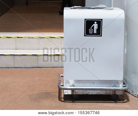 White bin with sign in the building