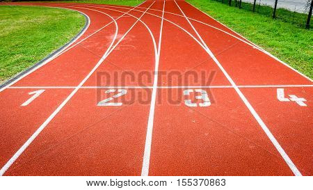 Start Numbers On Athletic Running Track In Stadium.