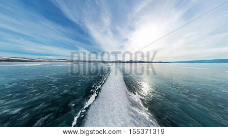 The Road From The Big White Cracks On The Ice Of Lake Baikal. The Polar Panorama