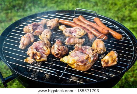 Delicious Variety Of Meat On Barbecue Grill With Char Coal.