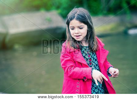 Pretty Little Girl Playing At The Water's Edge