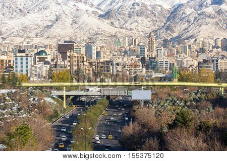 Winter Tehran view with a snow covered Alborz Mountains on background. Panorama