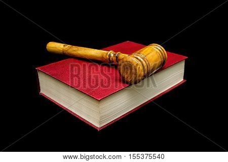Judge gavel and book on a black background. horizontal photo.