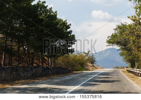 Russian .Crimea. Sudak. Road on background of mountains and trees . 14.09.2016