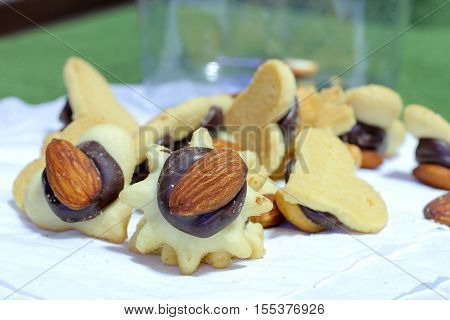 heart-shaped cookie cutter and almond nuts .