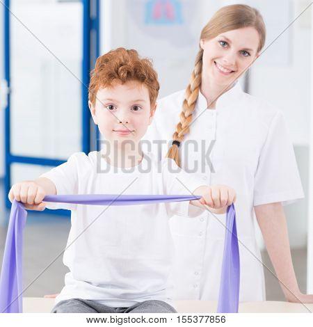 Boy Exercising With Elastic Band