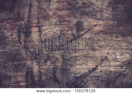 Old wood cracked background swollen damage .