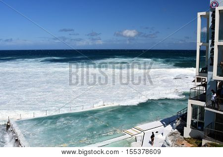 Sydney, Australia - Oct 23, 2016. Bondi Iceberg's swimming pools with ocean view at high tide. Big tide at Bondi beach the waves fill the Icebergs Club pool.