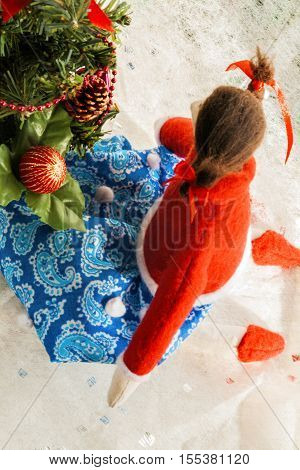 Soft Textile Doll Near A Christmas Tree With Gifts