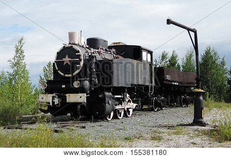 The old steam locomotive standing on sidings.