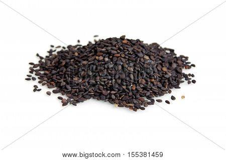 Pile Of Black Sesame Seeds Isolated On White Background
