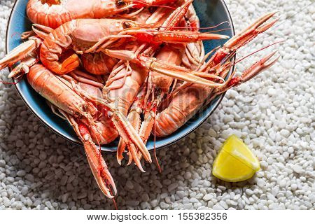 Scampi Served With Lemon On The Beach