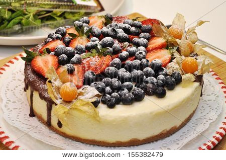 sponge cake with fresh berries isolated on the white