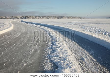 Frozen lake with ice road on it