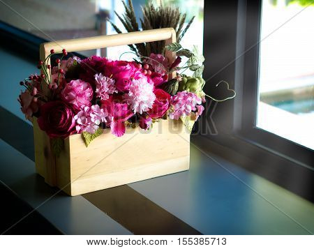 Artificial Flowers In A Wooden Box. The Side Windows.