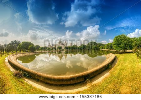 Beautiful panoramic image of Victoria Memorial Kolkata Calcutta West Bengal India . A Historical Monument of Indian Architecture. Huge lake in foregreound stock image.