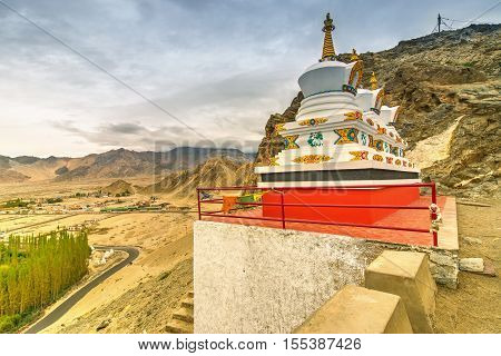 Thiksay monastery with view of Himalayan mountians and blue sky with white clouds in backgroundLadakhJammu and Kashmir India