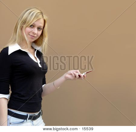 Blond Girl With A Phone