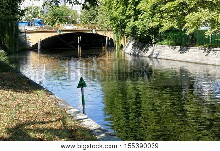 BERLIN GERMANY. SEPTEMBER 2ND 2016 - Canal in Berlin with trees on sides building and traffic in background