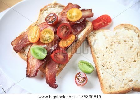 Bacon and cherry tomato sandwich on white bread with mayonnaise