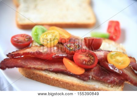 Thick-bacon with cherry tomatoes on whole-grain bread with mayonnaise
