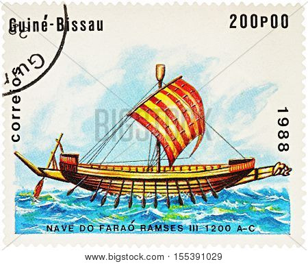 MOSCOW RUSSIA - NOVEMBER 04 2016: A stamp printed in Guinea-Bissau shows image of ancient Egyptian ship times Pharaoh Ramses III (1200 B.C.) series