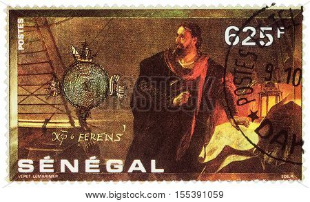 MOSCOW RUSSIA - NOVEMBER 04 2016: A stamp printed in Senegal shows Christopher Columbus with a map on the ship series