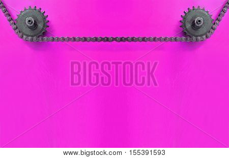 Black Metal cogwheels and chain on purple background with empty space for text.