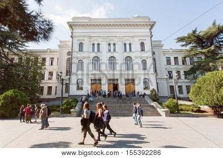 TBILISI, GEORGIA - OCT 10, 2016: Students walking past main building of the Tbilisi State University established 1918 on October 10, 2016. Tbilisi has a population of 1.5 million people