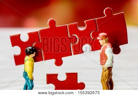 business team work building a puzzle, business idea and sucess concept