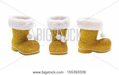 Set of empty golden boots of Santa Claus isolated