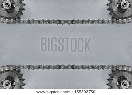 Metal cogwheels and double chain on grey background with empty space for text.Technology background.