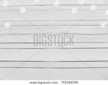 Christmas New year winter mockup scene with snowflake paper confetti and empty space. White wooden background. Top view.