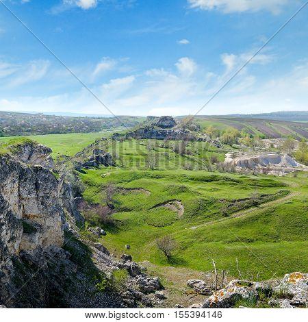 Deposits of limestone quarry green hills and rural landscape