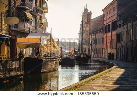venice village sunset romantic haze shadow boat restaurant warm tone canal