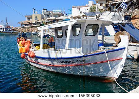 SISSI, CRETE - SEPTEMBER 14, 2016 - Traditional Greek fishing boat moored in the harbour Sissi Crete Greece Europe, September 14, 2016.