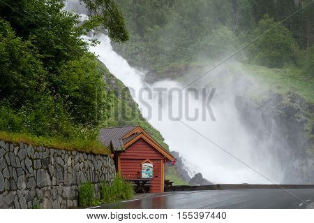 Famous Norwegian waterfall Latefoss, popular touristic attraction, Odda Hordaland County in Norway. poster