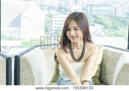 Asian woman smiling with dimple long hair black eyes