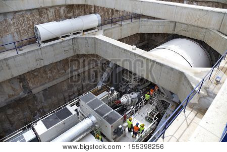 A huge underground tunnel drill, prepared to start drilling in a shaft.