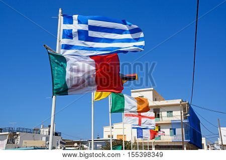 SISSI, CRETE - SEPTEMBER 14, 2016 - Row of European flags with town buildings to the rear Sissi Crete Europe, September 14, 2016.