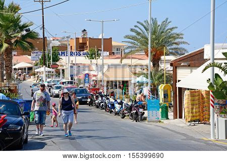 STALIDA, CRETE - SEPTEMBER 14, 2016 - Holidaymakers walking along a tourist shopping street Stalida Crete Europe, September 14, 2016.