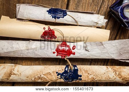 Scroll with the envelope symbol imprinted in sealing wax