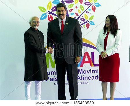 Porlamar Venezuela. September 17th 2016: Indian Vice President Hamid Ansari greets Venezuelan President Nicolas Maduro at the opening ceremony of the Non-Aligned Movement Summit in Porlamar Venezuela