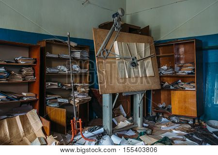 Abandoned office of engineer with panel board in abandoned meat Processing Plant in Alekseyevka, Belgorod region