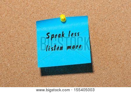 Speak Less Listen More sticker pinned at notice board background.