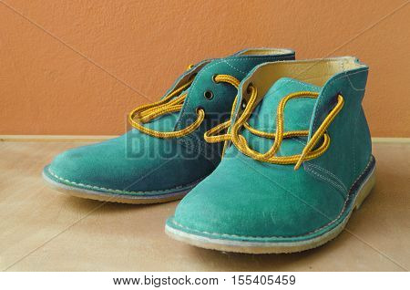 blue casual  suede shoes A shoestring yellow A suede classic style luxury Casual accommodation on the wooden floor